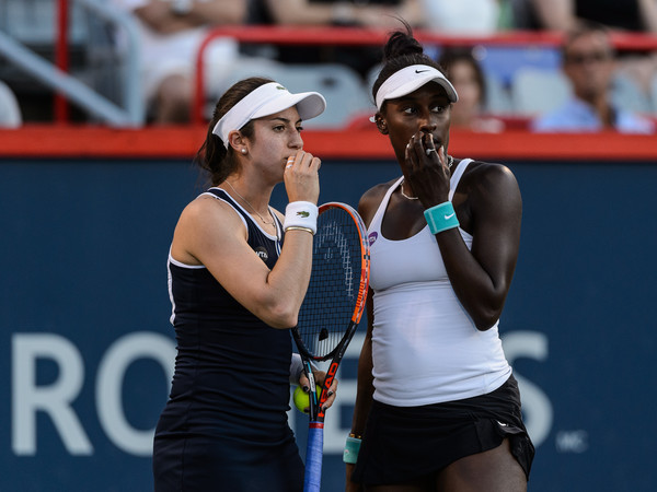 Christina McHale and Asia Muhammad discuss tactics in their semifinal match against Makarova and Vesnina at last year's Rogers Cup | Photo: Minas Panagiotakis/Getty Images North America