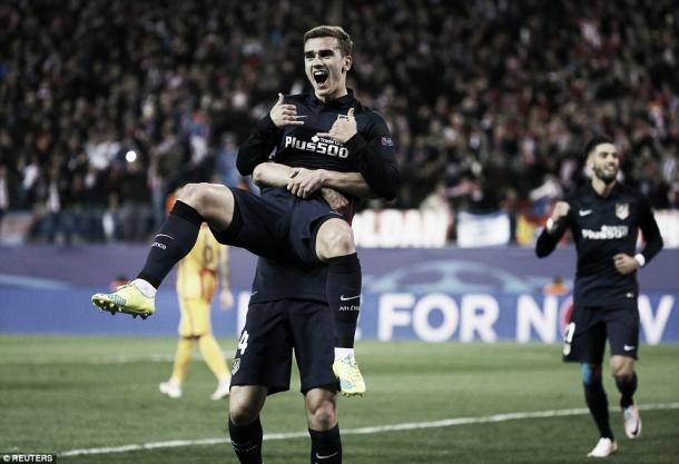 Above: Antoine Griezmann scores a brace in Atletico Madrid's 2-0 win over Barcelona | Reuters