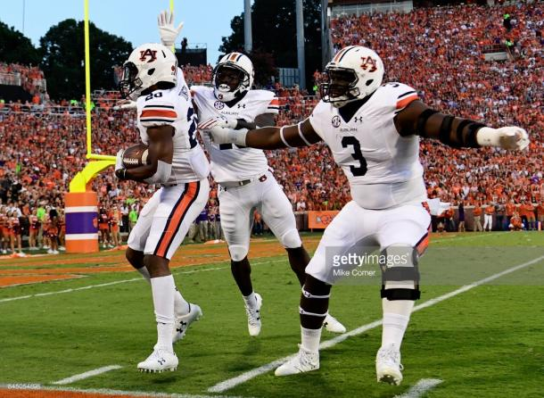 Auburn sophomore Marlon Davidson (3) celebrates with his teammates during the Clemson game.
