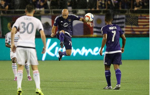 Aurelien Collin #78 of Orlando City SC makes a leaping play on the ball during a MLS soccer match between the Chicago Fire and the Orlando City SC at the Orlando Citrus Bowl on August 29, 2015 in Orlando, Florida. (Photo by Alex Menendez/Getty Images