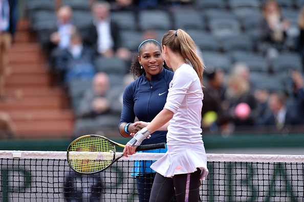 Williams and Rybarikova meet at the net after their brief encounter (Getty/Aurelien Meunier)
