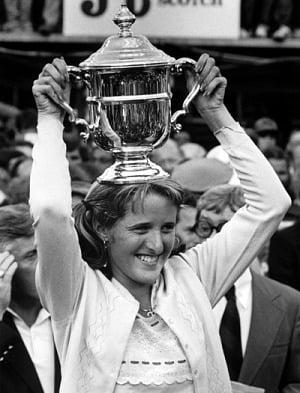 Tracy Austin hoists her 1979 US Open trophy. Photo: Tennis Magazine