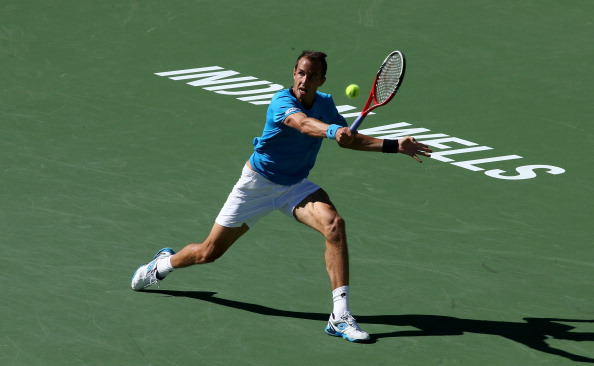 Lukas Rosol hits a retrun to Andy Murray during the BNP Paribas Open (Photo:Stephen Dunn/Getty Images)