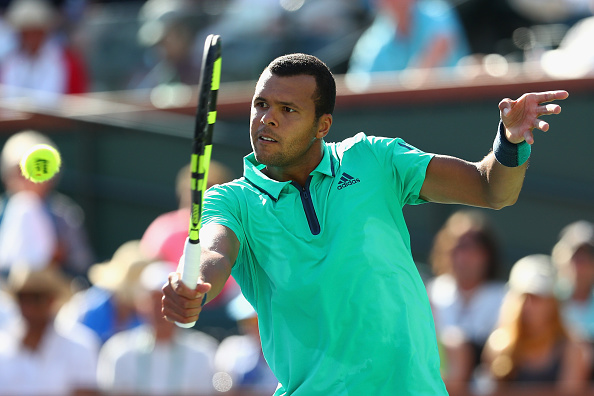 Jo-Wilfried Tsonga in action against Novak Djokovic during day twelve of the BNP Paribas Open at Indian Wells (Photo:Julian Finney/Getty Images)