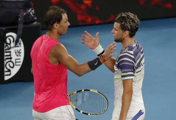 The two combatants meet at the net after their quarterfinal epic/Photo: Isae8 Katp/Reuters