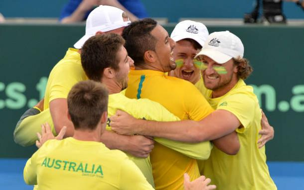 Nick Kyrgios celebrates with his team mates after securing the Davis Cup tie against the USA (Getty/Bradley Kanaris)