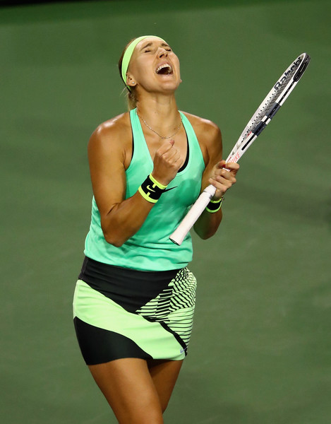 Elena Vesnina celebrates the hard-fought victory | Photo: Clive Brunskill/Getty Images North America