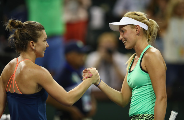 Both players meet at the net after the match | Photo: Clive Brunskill/Getty Images North America