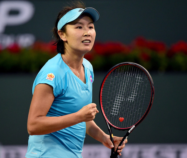 Peng Shuai celebrates to winning a point | Photo: Harry How/Getty Images North America