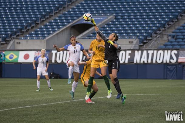 Alana Kennedy (center) as she makes an attempt to head the ball for Australia | Source: Brandon Farris - VAVEL USA