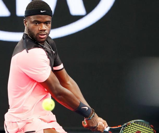 Photo Source: Michael Dodge/Getty Images: Frances Tiafoe hits a backhand winner.