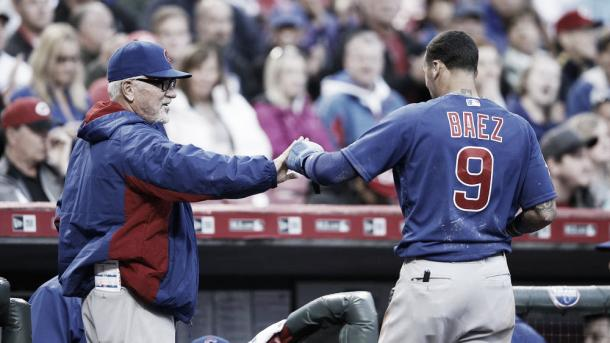 The Cubs' Javier Baez is congratulated by manager Joe Maddon after scoring on a sacrifice fly by David Ross in the second inning of the game against the Cincinnati Reds at Great American Ball Park on April 22, 2016, in Cincinnati.(Joe Robbins/Getty Images