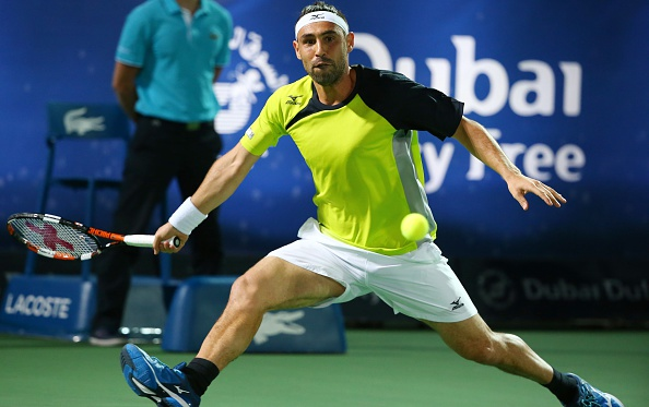 Marcos Baghdatis chases down a forehand during the final. Photo: Marwan Naamani/AFP/Getty Images