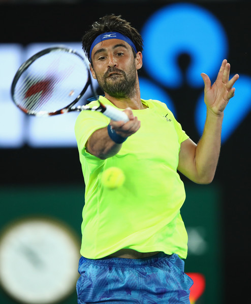 Marcos Baghdatis hits a forehand on Thursday night in Melbourne. Photo: Clive Brunskill/Getty Images