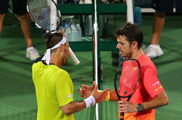 Baghdatis (left) and Wawrinka shake hands after the match. Photo: Marwan Naamani/AFP/Getty Images