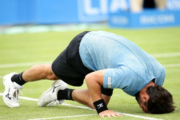 Baghdatis kisses the grass on Centre Court after his victory. Photo: Getty