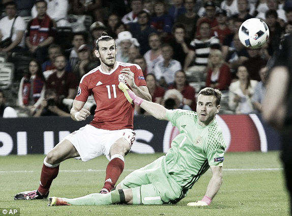 Above: Gareth Bale scoring his goal in Wales' 3-0 win over Russia | Photo: AP