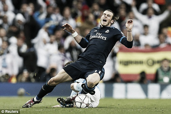 Above; Gareth Bale is fouled during Real Madrid's 0-0 draw with Manchester City | Photo: Reuters