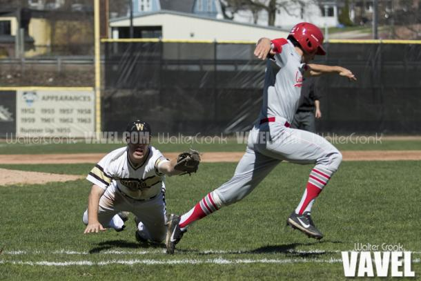 Jesse Forestell (27) dives to tag the runner going to 1st base but cant get to him in time. Photo: Walter Cronk