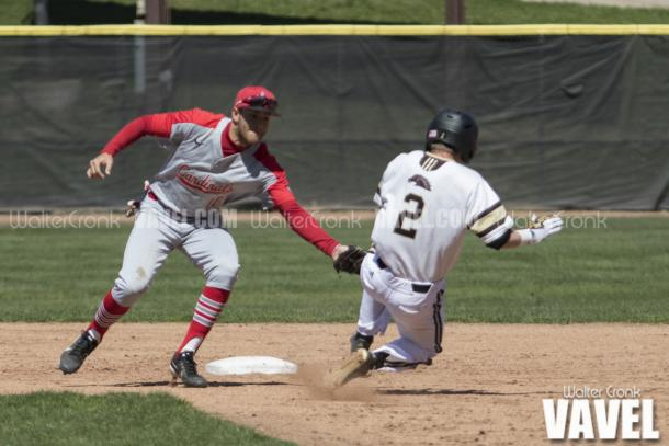 Connor Smith (2) gets tagged out by Sean Kennedy (10) trying to steal second base. Photo: Walter Cronk