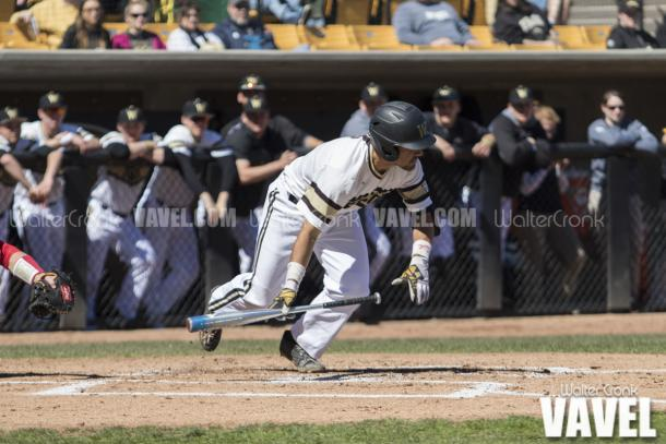 Grant Miller (1) attempting to bunt and move the runner to second base. Photo: Walter Cronk