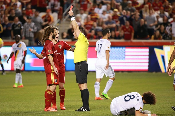 Sorin Stoica shows a red card to Kyle Beckerman during a March 18, 2017 match between Real Salt Lake and the Los Angeles Galaxy. | Photo: Chris Nicoll, USA TODAY Sports