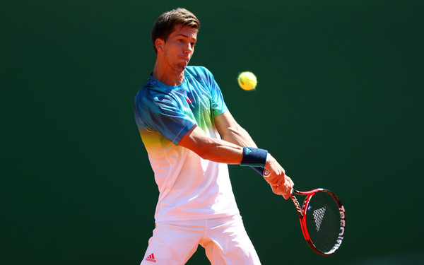 Aljaz Bedene hits one of his many backhands during his match with Nadal. Photo: Michael Steele/Getty Images
