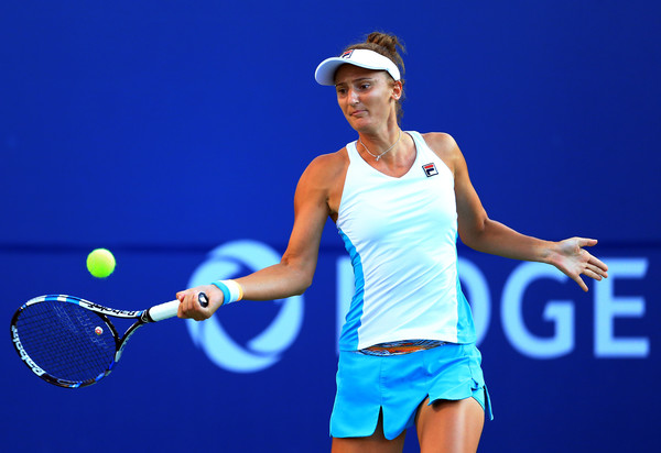 Irina-Camelia Begu strikes a forehand during her first-round loss. Photo: Vaughn Ridley/Getty Images