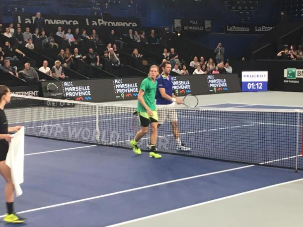 Shapovalov (in green) and Benneteau shake hands after the match. Photo: Open 13 Marseille