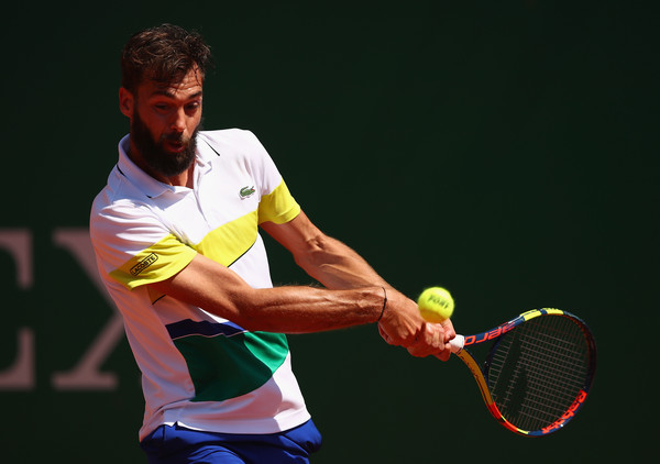 Benoit Paire of France plays a backhand against Tommy Haas of Germany in his first round match on day three of the Monte Carlo Rolex Masters at Monte-Carlo Sporting Club on April 18, 2017 in Monte-Carlo, Monaco. (Photo by Clive Brunskill/Getty Images Europe)