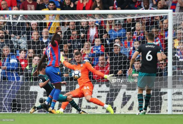 Benteke forces Forster into a point-blank save. Source | Getty Images.