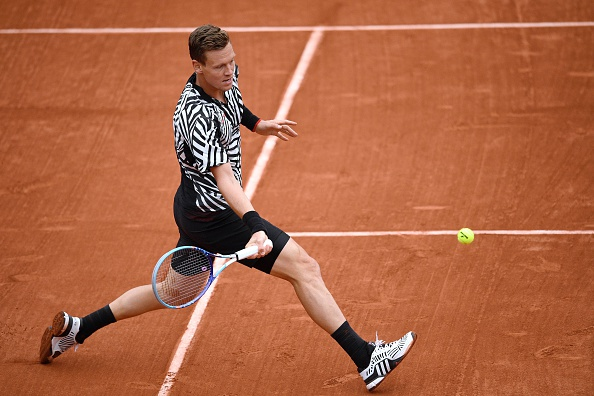 Tomas Berdych steps into a forehand during the quarterfinal. Photo: Martin Bureau/AFP/Getty Images