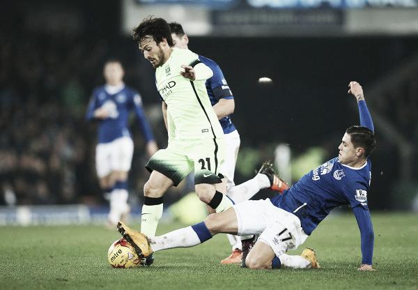 Muhamed Besic tackles David Silva. Photo: Zimbo