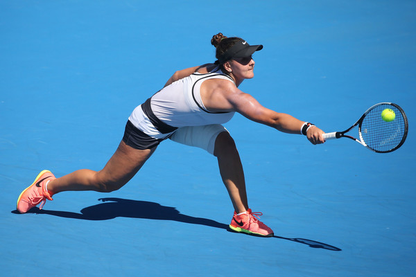 Bianca Vanessa Andreescu lunges for a defensive backhand shot during her semifinal match against Rebeka Masarova at the 2017 Australian Open Junior Championships. | Photo: Pat Scala/Getty Images