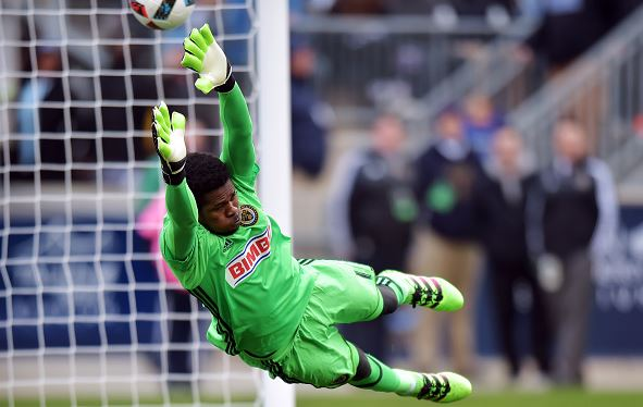 Goalkeeper Andre Blake of Philadelphia Union dives to make a save as the ball get past him and bounces off the post against the New England Revolution at Talen Energy Stadium on March 20, 2016 in Chester, Pennsylvania / Drew Hallowell - Getty Images