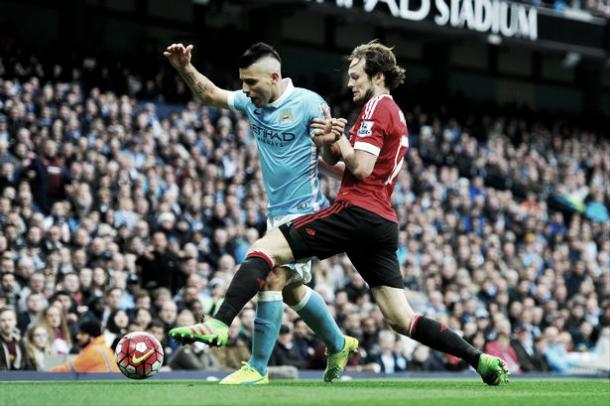 Sergio Aguero and Daley Blind battle for the ball in last season's Derby - Picture: Getty