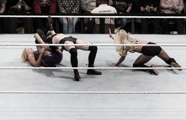 Paige and Charlotte locked up in a submission.