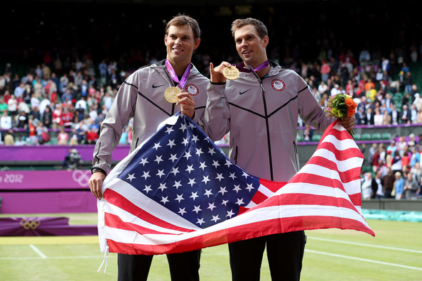 Bob and Mike Bryan pose with their gold medals after the men's doubles prize ceremony at the 2012 London Olympics.