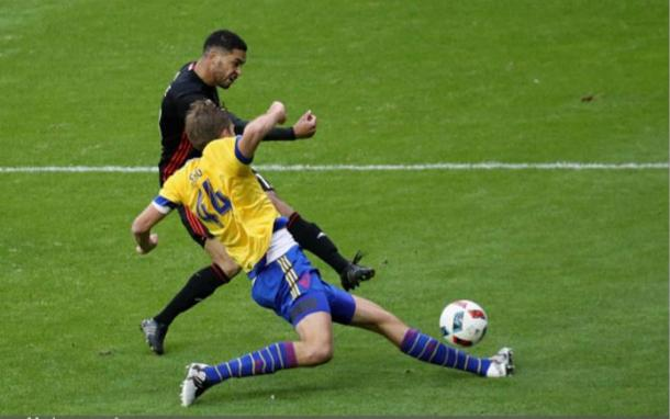 Colorado Rapids center back Axel Sjoberg (in yellow, sliding) has been a rock at the back for the Rapids this season. Photo credit: Rob Carr/Getty Images Sport