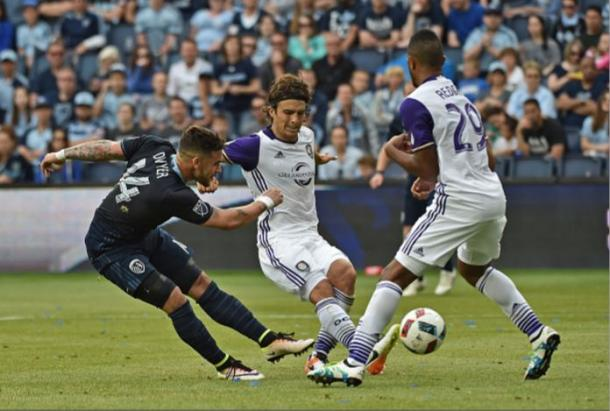 Sporting Kansas City forward Dominic Dwyer (left, in dark blue) has scored four goals in his last four MLS matches. Photo credit: Peter G. Aiken/Getty Images Sport