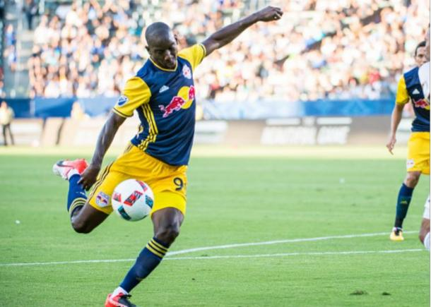 New York Red Bulls forward Bradley Wright-Phillips (center, #99, in blue) has scored seven goals in his last six matches. Photo credit: Tim Clayton/Getty Images Sport