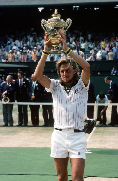 Borg hoists his 1976 Wimbledon trophy. Photo: Tony Duffy/Allsport