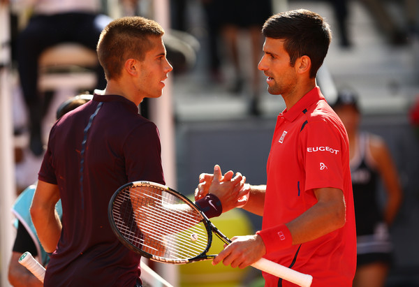 Borna Coric and Novak Djokovic in Mutua Madrid Open action. Photo: Clive Brunskill/Getty Images