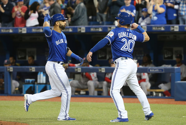 Jose Bautista and Josh Donaldson celebrate after Bautista's home run in the bottom of the first inning. (Source: Tom Szczerbowski/Getty Images North America)