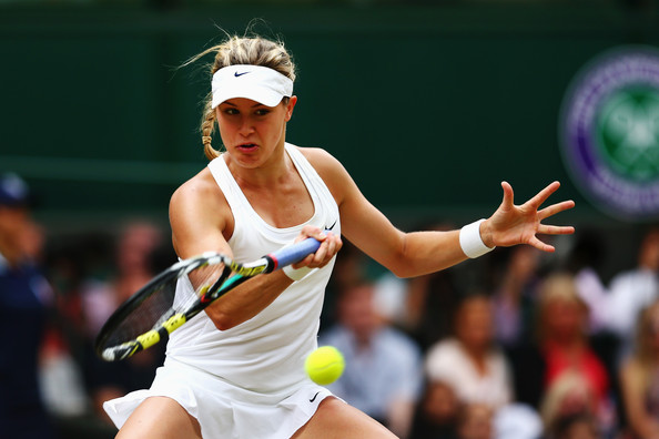 Bouchard hits a forehand during the 2014 Wimbledon final. Photo: Clive Brunskill/Getty Images