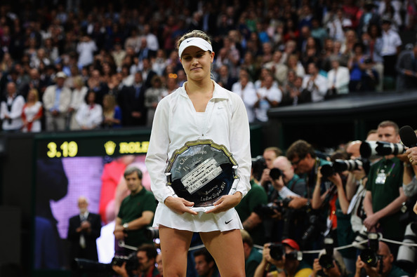 Bouchard holds her runner-up trophy after the 2014 final. Photo: Getty Images