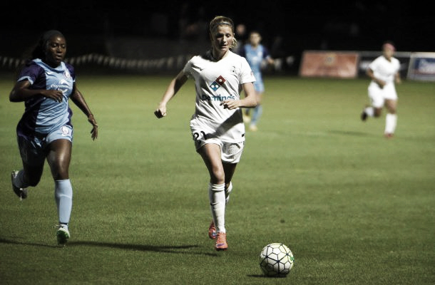 Katie Bowen chases after the ball |
