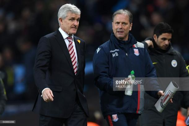 Mark Hughes (L) with assistant Mark Bowen (R) at the Etihad earlier this year. Source | Getty Images.