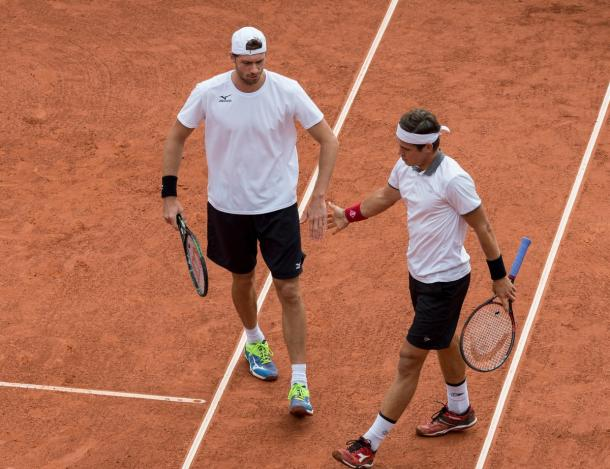 Brands and Masur high five during their doubles match. Photo: Davis Cup