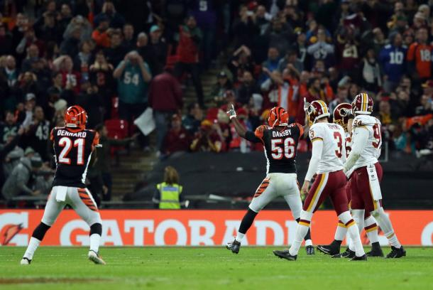 The Bengals celebrate with a sigh of relief after Hopkins' missed field goal (AP Photo/Tim Ireland)